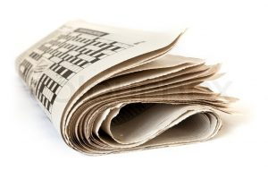 2570628-fold-up-newspaper-isolated-on-white-background